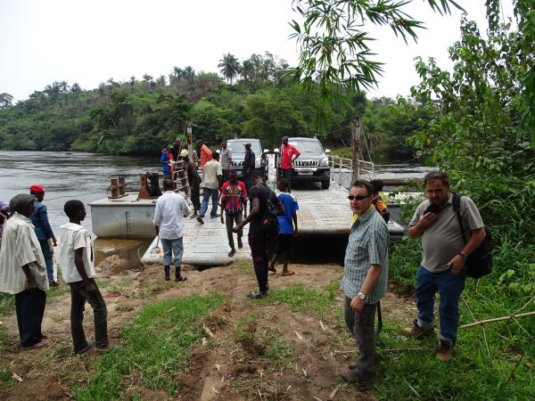 09 The engine of the ferry has been stolen and villagers help by pulling the ferry to the river bank
