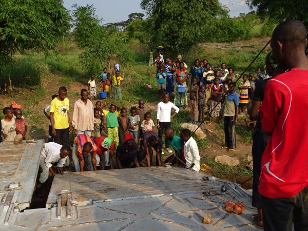 15 The ferry is blocked and the villagers kindly help to move it